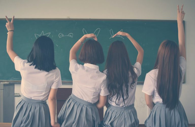 photo-of-four-girls-wearing-school-uniform-doing-hand-signs-710743